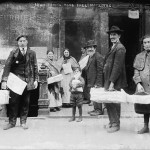 Poor Jews taking free matzoh in 1906 in NYC.